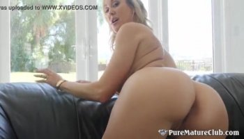 Hot brunette gags on sucking a big cock